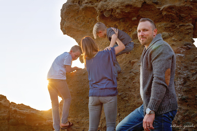 family photo session in laguna beach at sunset with their bulldog by allison jacobs photography